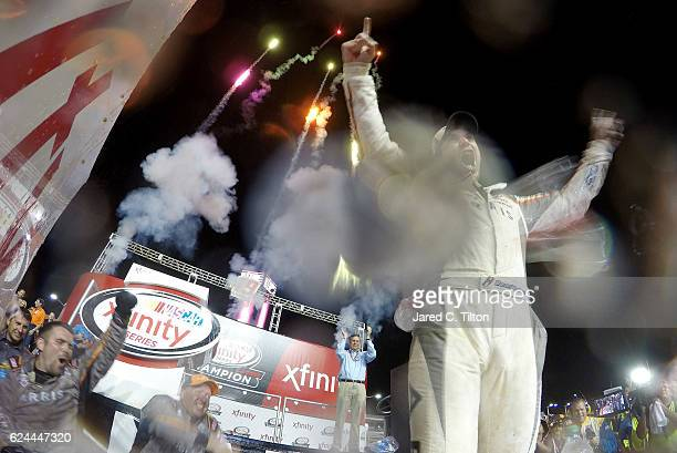 Daniel Suarez driver of the ARRIS Toyota celebrates in Victory Lane after winning the NASCAR XFINITY Series Ford EcoBoost 300 and the NASCAR XFINITY...