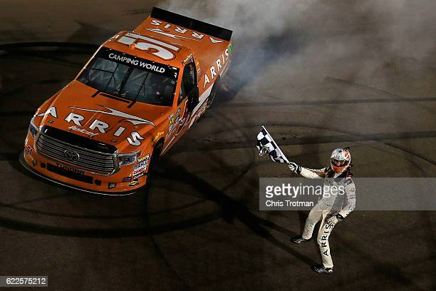 Daniel Suarez driver of the ARRIS Toyota celebrates winning the NASCAR Camping World Truck Series Lucas Oil 150 at Phoenix International Raceway on...