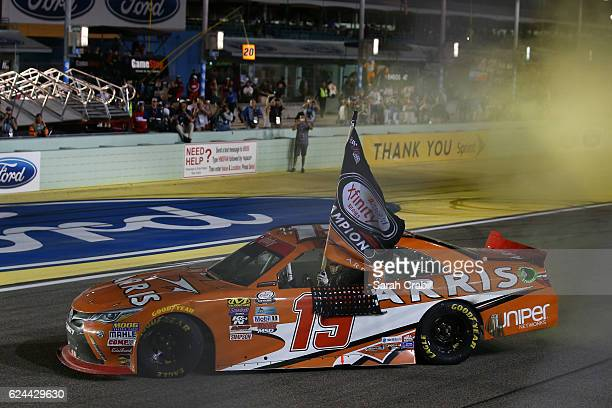 Daniel Suarez driver of the ARRIS Toyota celebrates winning the NASCAR XFINITY Series Ford EcoBoost 300 and the NASCAR XFINITY Series Championship at...