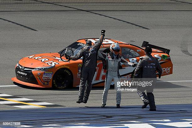 Daniel Suarez driver of the ARRIS Toyota celebrates with his crew members after winning the NASCAR XFINITY Series Menards 250 at Michigan...