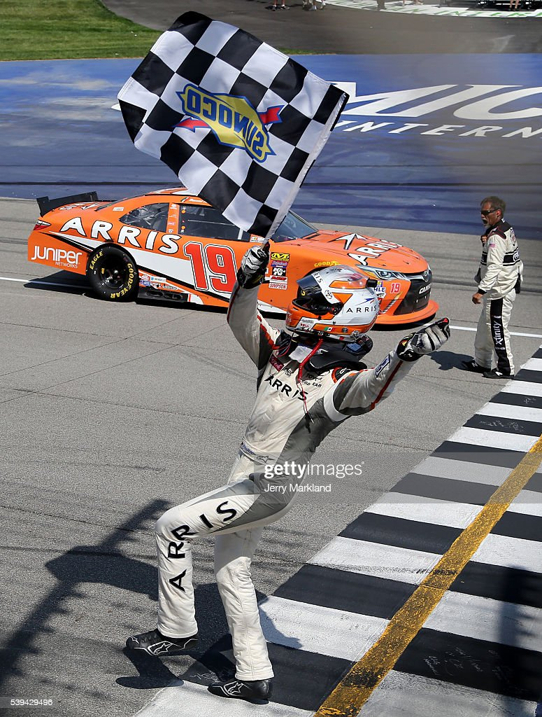 Daniel Suarez driver of the ARRIS Toyota celebrates with the checkered flag after winning the NASCAR XFINITY Series Menards 250 at Michigan...