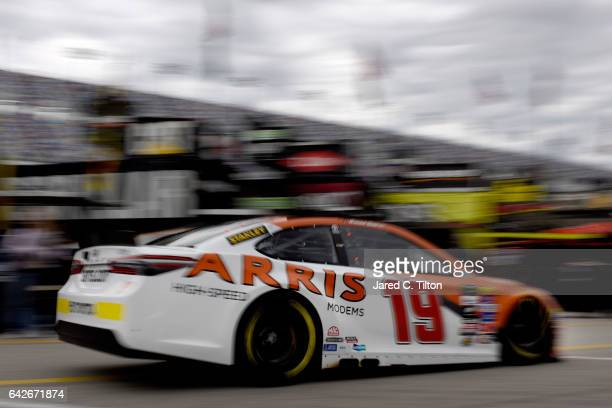Daniel Suarez driver of the ARRIS Toyota drives through the garage during practice for the Monster Energy NASCAR Cup Series 59th Annual DAYTONA 500...