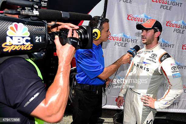 Daniel Suarez driver of the ARRIS Toyota is interviewed by NBC Sports after qualifying on the pole for the NASCAR XFINITY Series Subway Firecracker...