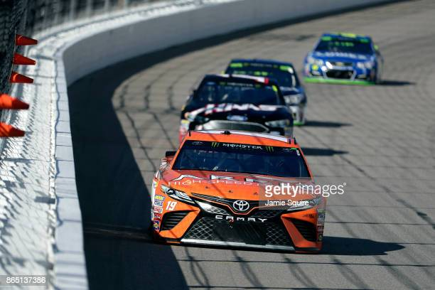 Daniel Suarez driver of the ARRIS Toyota leads a pack of cars during the Monster Energy NASCAR Cup Series Hollywood Casino 400 at Kansas Speedway on...