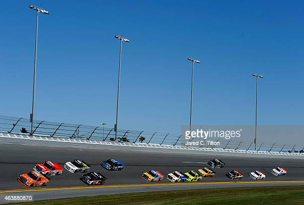 Daniel Suarez driver of the ARRIS Toyota leads a pack of trucks during practice for the NASCAR Camping World Truck Series NextEra Energy Resources...