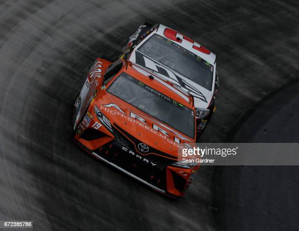 Daniel Suarez driver of the ARRIS Toyota leads Austin Dillon driver of the New Era Cap Chevrolet during the Monster Energy NASCAR Cup Series Food...