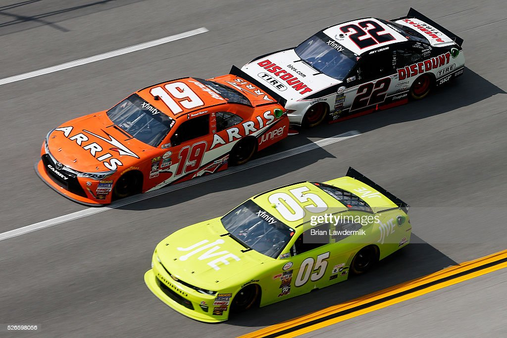 Daniel Suarez, driver of the #19 ARRIS Toyota, leads <a gi-track='captionPersonalityLinkClicked' href=/galleries/search?phrase=John+Wes+Townley&family=editorial&specificpeople=5400343 ng-click='$event.stopPropagation()'>John Wes Townley</a>, driver of the #05 Jive Communications Chevrolet, and <a gi-track='captionPersonalityLinkClicked' href=/galleries/search?phrase=Joey+Logano&family=editorial&specificpeople=4510426 ng-click='$event.stopPropagation()'>Joey Logano</a>, driver of the #22 Discount Tire Ford, during the NASCAR XFINITY Series Sparks Energy 300 at Talladega Superspeedway on April 30, 2016 in Talladega, Alabama.