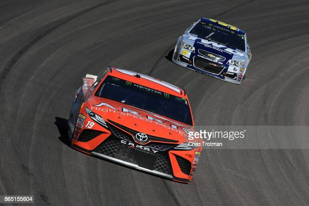 Daniel Suarez driver of the ARRIS Toyota leads Michael McDowell driver of the TWD Chevrolet during the Monster Energy NASCAR Cup Series Hollywood...