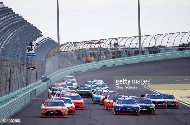 Daniel Suarez driver of the ARRIS Toyota leads the field past the green flag to start the NASCAR XFINITY Series Ford EcoBoost 300 at HomesteadMiami...