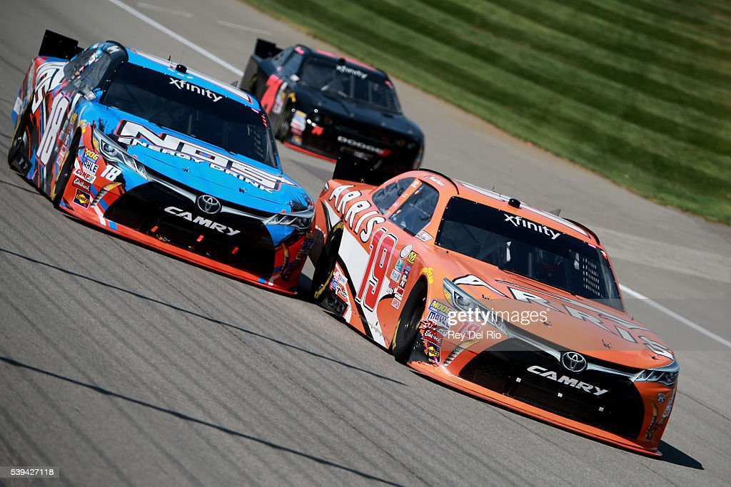 Daniel Suarez driver of the ARRIS Toyota passes Kyle Busch driver of the NOS Energy Drink Toyota during the NASCAR XFINITY Series Menards 250 at...