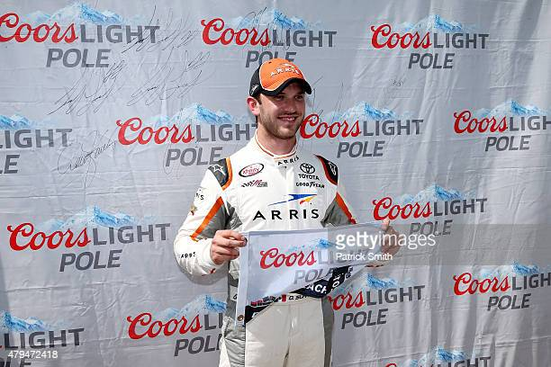 Daniel Suarez driver of the ARRIS Toyota poses with the Coors Light Pole Award after qualifying on the pole for the NASCAR XFINITY Series Subway...