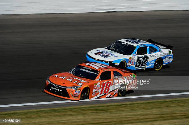 Daniel Suarez driver of the ARRIS Toyota races with Joey Gase driver of the Chevrolet during the NASCAR XFINITY Series Kansas Lottery 300 at Kansas...