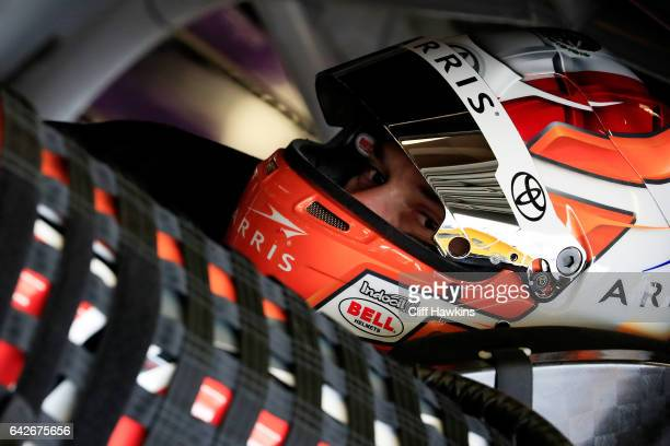 Daniel Suarez driver of the ARRIS Toyota sits in his car during practice for the Monster Energy NASCAR Cup Series 59th Annual DAYTONA 500 at Daytona...