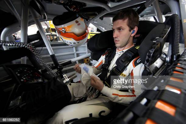 Daniel Suarez driver of the ARRIS Toyota sits in his car during practice for the Monster Energy NASCAR Cup Series Kobalt 400 at Las Vegas Motor...