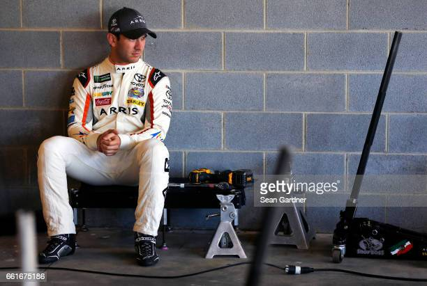 Daniel Suarez driver of the ARRIS Toyota sits in the garage during practice for the Monster Energy NASCAR Cup Series STP 500 at Martinsville Speedway...