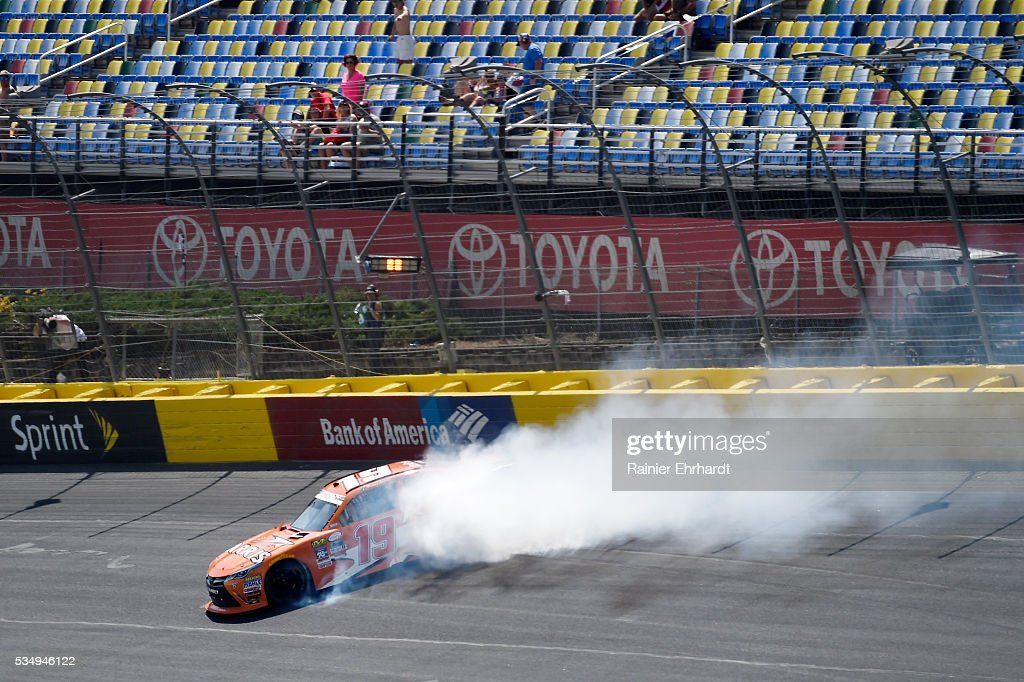 Daniel Suarez, driver of the #19 ARRIS Toyota, spins in turn four during the NASCAR XFINITY Series Hisense 300 at Charlotte Motor Speedway on May 28, 2016 in Charlotte, North Carolina.