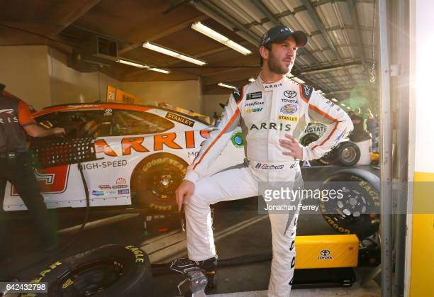 Daniel Suarez driver of the ARRIS Toyota stands in the garage area during practice for the Monster Energy NASCAR Cup Series Advance Auto Parts Clash...