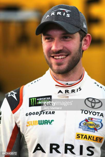 Daniel Suarez driver of the ARRIS Toyota stands in the garage during practice for the Monster Energy NASCAR Cup Series Advance Auto Parts Clash on...