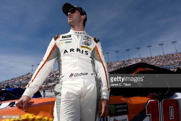 Daniel Suarez driver of the ARRIS Toyota stands on the grid prior to the Monster Energy NASCAR Cup Series Kobalt 400 at Las Vegas Motor Speedway on...