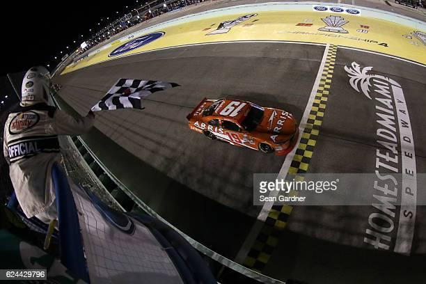 Daniel Suarez driver of the ARRIS Toyota takes the checkered flag to win the NASCAR XFINITY Series Ford EcoBoost 300 and the NASCAR XFINITY Series...