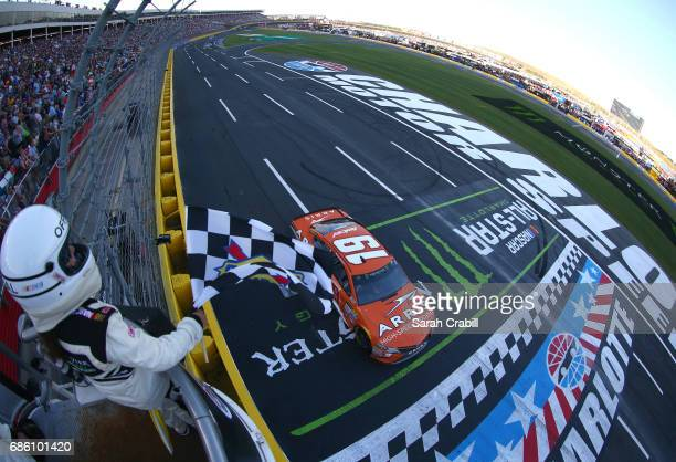 Daniel Suarez driver of the ARRIS Toyota takes the checkered flag to win Stage 3 of the Monster Energy NASCAR Open at Charlotte Motor Speedway on May...