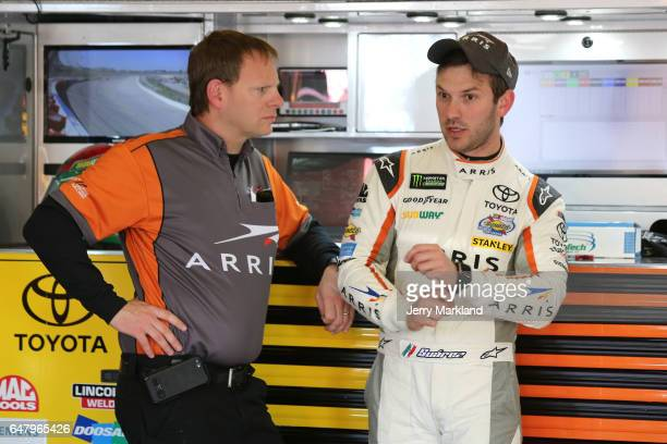 Daniel Suarez driver of the ARRIS Toyota talks with his crew chief Dave Rogers during practice for the Monster Energy NASCAR Cup Series Folds of...