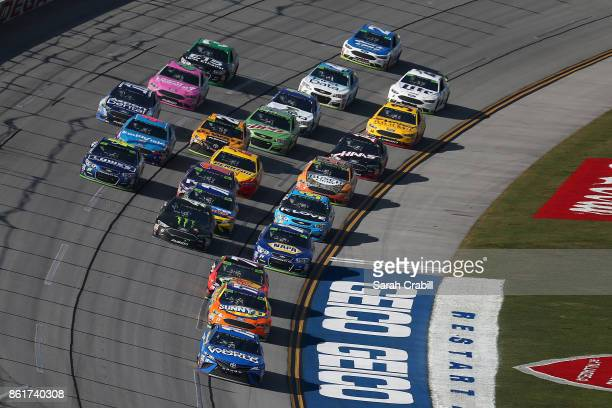 Daniel Suarez driver of the Camping World Toyota and Ricky Stenhouse Jr driver of the SunnyD Ford lead a pack of cars during the Monster Energy...