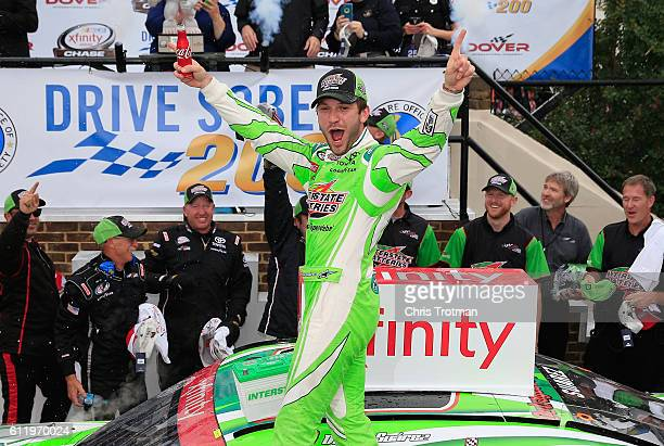 Daniel Suarez driver of the Interstate Batteries Toyota celebrates in Victory Lane after winning the NASCAR XFINITY Series Drive Sober 200 at Dover...