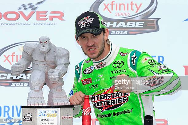 Daniel Suarez driver of the Interstate Batteries Toyota celebrates with the trophy in Victory Lane after winning the NASCAR XFINITY Series Drive...