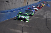 Daniel Suarez driver of the Interstate Batteries Toyota leads a pack of cars during the NASCAR Xfinity Series TreatMyClotcom 300 at Auto Club...