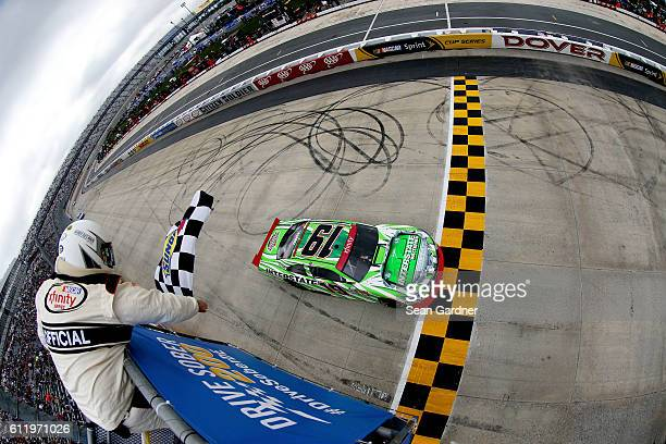 Daniel Suarez driver of the Interstate Batteries Toyota takes the checkered flag to win the NASCAR XFINITY Series Drive Sober 200 at Dover...