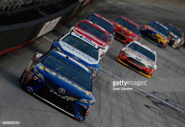 Daniel Suarez driver of the IRWIN/LENOX Toyota leads a pack of cars during the Monster Energy NASCAR Cup Series Bass Pro Shops NRA Night Race at...