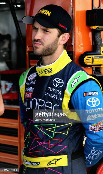 Daniel Suarez driver of the IRWIN/LENOX Toyota stands by his car during qualifying for the Monster Energy NASCAR Cup Series Bass Pro Shops NRA Night...