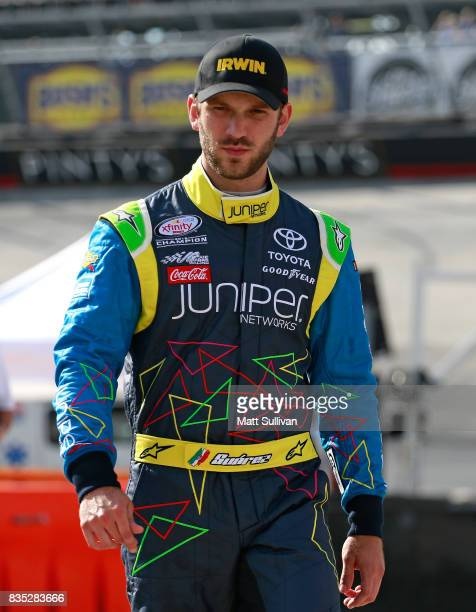 Daniel Suarez driver of the IRWIN/LENOX Toyota walks to his car during qualifying for the Monster Energy NASCAR Cup Series Bass Pro Shops NRA Night...