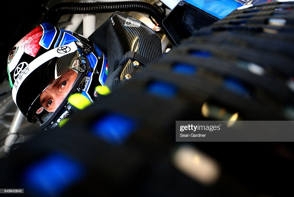 Daniel Suarez, driver of the #19 Juniper Networks Toyota, sits in his car during practice for the NASCAR XFINITY Series Subway Firecracker 250 at Daytona International Speedway on June 30, 2016 in Daytona Beach, Florida.
