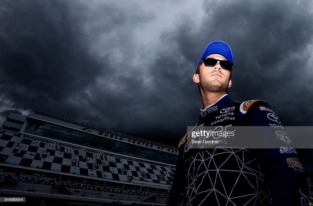 Daniel Suarez, driver of the #19 Juniper Networks Toyota, stands on the grid during qualifying for the NASCAR XFINITY Series Subway Firecracker 250 at Daytona International Speedway on July 1, 2016 in Daytona Beach, Florida.