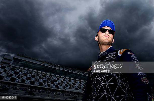Daniel Suarez driver of the Juniper Networks Toyota stands on the grid during qualifying for the NASCAR XFINITY Series Subway Firecracker 250 at...