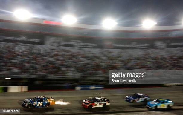 Daniel Suarez driver of the Juniper Toyota leads a pack of cars during the NASCAR XFINITY Series Food City 300 at Bristol Motor Speedway on August 18...