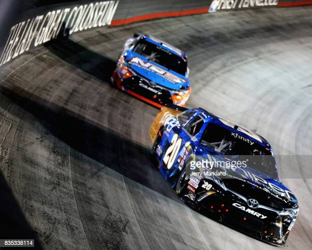 Daniel Suarez driver of the Juniper Toyota leads Kyle Busch driver of the NOS Rowdy Toyota during the NASCAR XFINITY Series Food City 300 at Bristol...