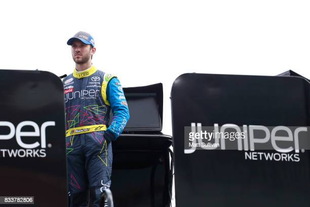 Daniel Suarez driver of the Juniper Toyota watches practice for the NASCAR Xfinity Series Food City 300 at Bristol Motor Speedway on August 17 2017...