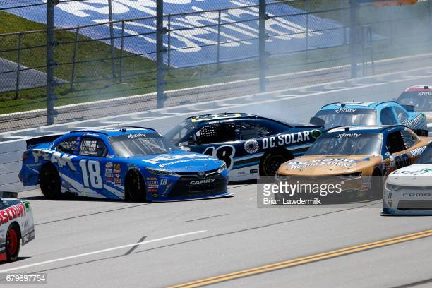 Daniel Suarez driver of the Peak Antifreeze Coolant Toyota and Brennan Poole driver of the DC Solar Chevrolet have an on track incident during the...