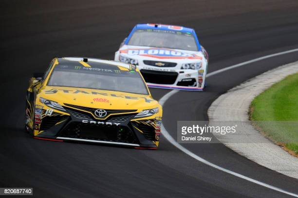 Daniel Suarez driver of the STANLEY Toyota and Chris Buescher driver of the Clorox Chevrolet practice for the Monster Energy NASCAR Cup Series...