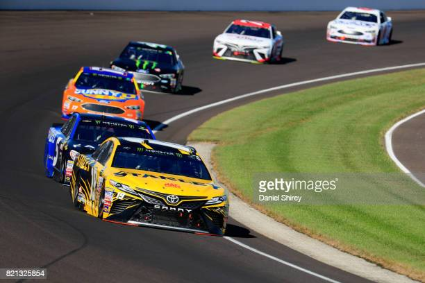 Daniel Suarez driver of the STANLEY Toyota leads a pack of cars during the Monster Energy NASCAR Cup Series Brickyard 400 at Indianapolis...