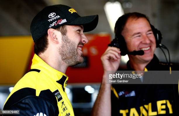 Daniel Suarez driver of the STANLEY Toyota stands in the garage area during practice for the Monster Energy NASCAR Cup Series O'Reilly Auto Parts 500...