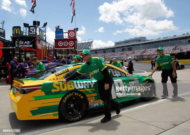 Daniel Suarez driver of the Subway Toyota has his car pushed through the garage area during practice for the Monster Energy NASCAR Cup Series...
