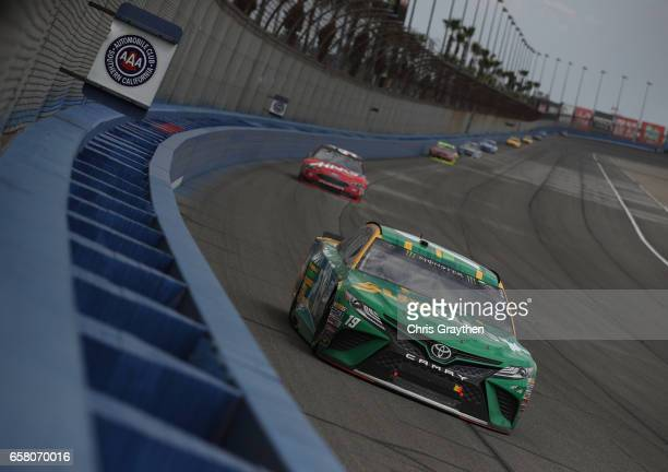 Daniel Suarez driver of the Subway Toyota leads a pack of cars during the Monster Energy NASCAR Cup Series Auto Club 400 at Auto Club Speedway on...