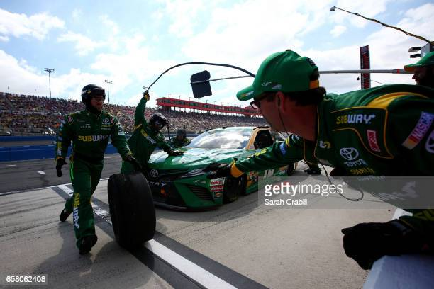 Daniel Suarez driver of the Subway Toyota pits during the Monster Energy NASCAR Cup Series Auto Club 400 at Auto Club Speedway on March 26 2017 in...