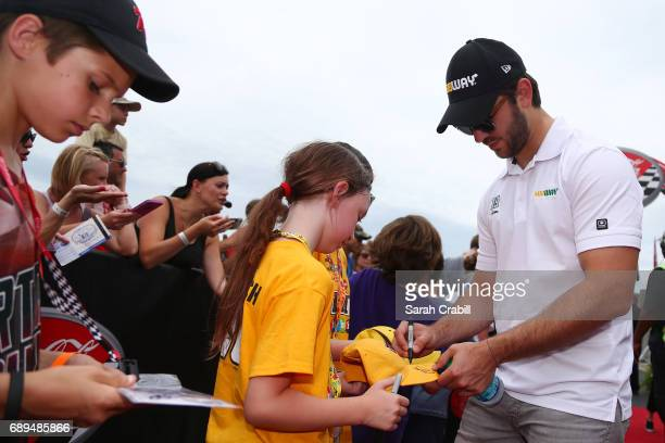 Daniel Suarez driver of the Subway Toyota signs autographs during the driver and crew chief meeting before the Monster Energy NASCAR Cup Series...