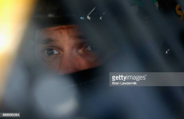 Daniel Suarez driver of the Subway Toyota sits in his car during practice for the Monster Energy NASCAR Series CocaCola 600 at Charlotte Motor...