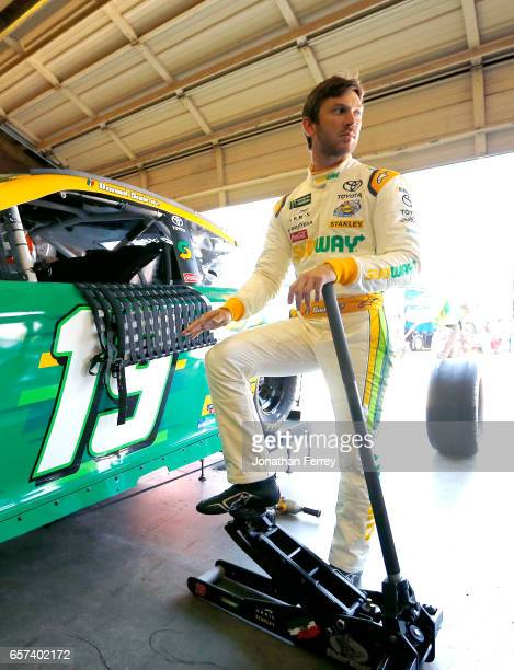 Daniel Suarez driver of the Subway Toyota stands in the garage during practice for the Monster Energy NASCAR Cup Series Auto Club 400 at Auto Club...